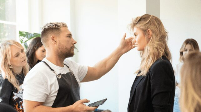 Professional Hair Dresser Jaye at Edwards And Co. Styling Woman With Beautiful Blond Hair